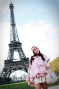 eiffel tower girl in cape coat
