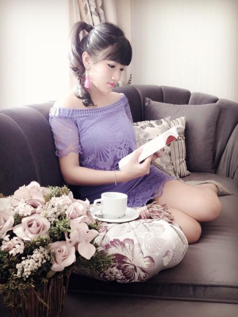 purple dress asian girl reading book