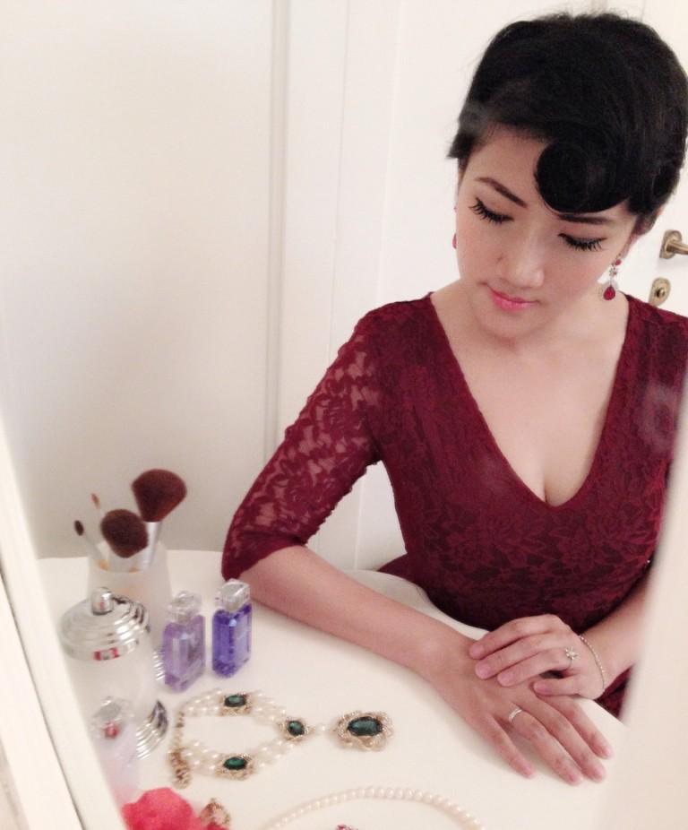girl sitting dressing table mirror