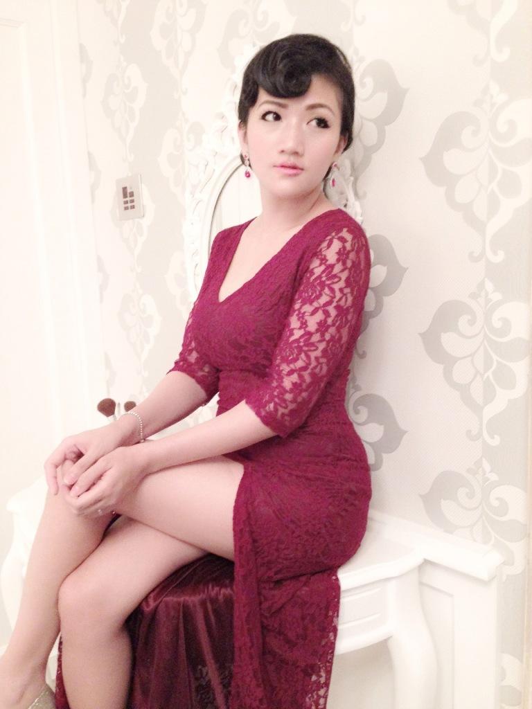 slit dress girl sitting dressing table