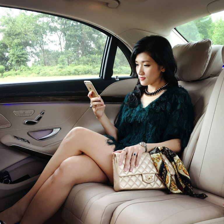gilr travel in car playing phone