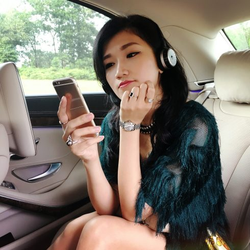 girl in car listening to music